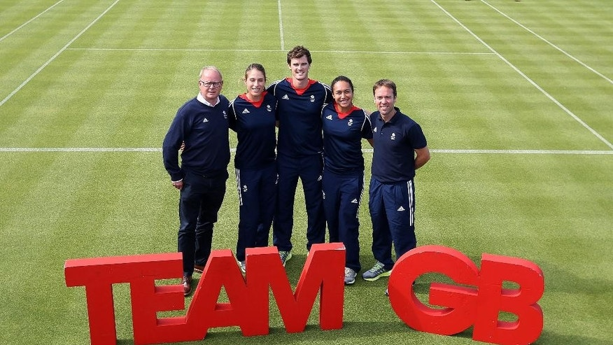 From left, Mark England, Team GB's Chef de Mission, Johanna Konta, Jamie Murray, Heather Watson and Iain Bates, Team GB Tennis Leader pose during the team announcement at the Queen's Club, London, Friday June 10, 2016. Defending Olympic champion Andy Murray will lead a four-member British tennis team at the Rio de Janeiro Games. (Steven Paston/PA via AP) UNITED KINGDOM OUT