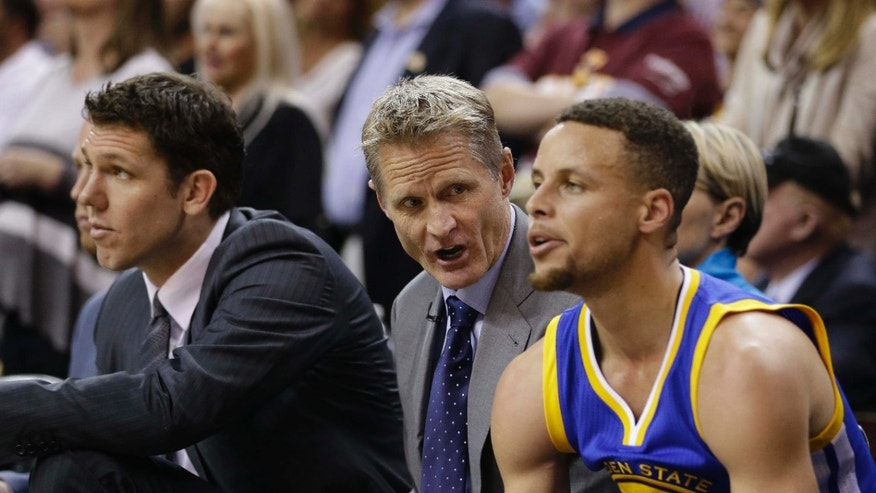 June 8, 2016: Golden State Warriors coach Steve Kerr, center, talks with guard Stephen Curry on the bench during the first half against the Cleveland Cavaliers in Game 3 of basketball's NBA Finals in Cleveland.