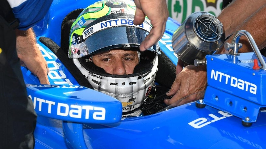 Tony Kanaan of Brazil sits on pit road as his crew makes adjustments to the car during an Indycar auto racing practice at Texas Motor Speedway , Friday, June 10, 2016, in Fort Worth, Texas. (AP Photo/Larry Papke)