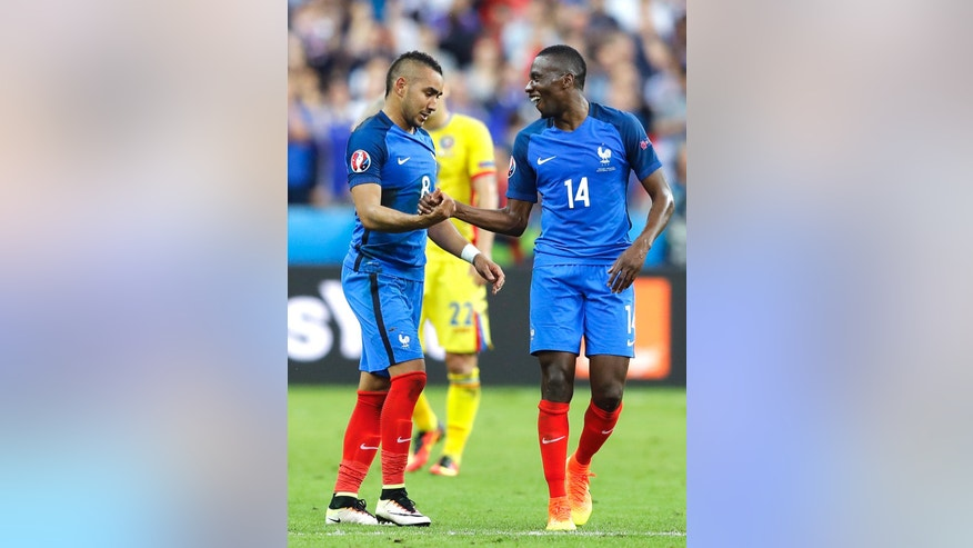 France's Dimitri Payet, left, celebrates with Blaise Matuidi after scoring, during the Euro 2016 Group A soccer match between France and Romania, at the Stade de France, in Saint-Denis, north of Paris, Friday, June 10, 2016. (AP Photo/Frank Augstein)