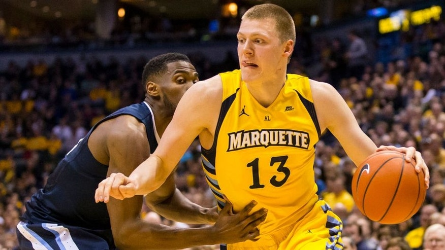 <p>Henry Ellenson drives for the basket during the first half against the top-ranked Villanova Wildcats at BMO Harris Bradley Center in Milwaukee.</p>