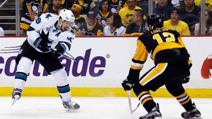 San Jose Sharks' Logan Couture, left, fires the puck past Pittsburgh Penguins' Ben Lovejoy during the second period in Game 5 of the NHL hockey Stanley Cup Finals on Thursday, June 9, 2016, in Pittsburgh. (AP Photo/Keith Srakocic)