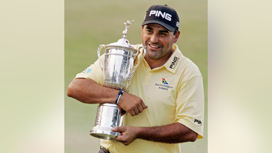 ** ADVANCE FOR WEEKEND EDITIONS, JUNE 7-9  ** FILE ** In this June 17, 2007 file photo, Angel Cabrera, of Argentina, hugs the trophy after winning the U.S. Open Golf Championship at the Oakmont Country Club in Oakmont, Pa. Cabrera returns to the U.S. Open at Oakmont as a legend to South Americans for his support of golf, an enigma to so many others as to why he hasn't won more. (AP Photo/Gene J. Puskar, File)