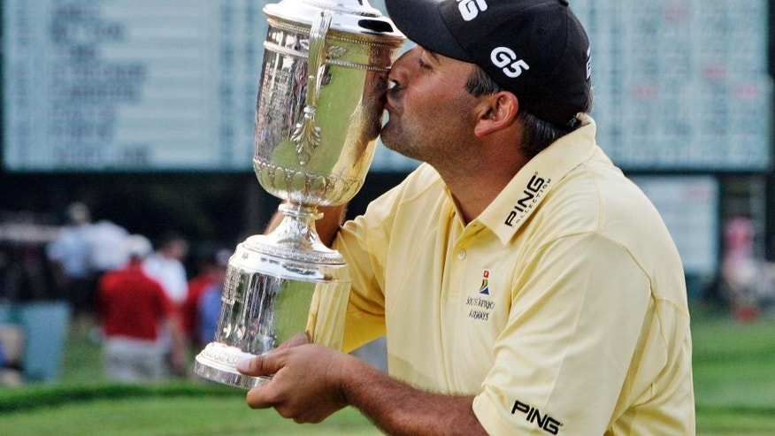 ADVANCE FOR WEEKEND EDITIONS, JUNE 11-12 - In this June 17, 2007, file photo, Angel Cabrera kisses the trophy after winning the 107th U.S. Open Golf Championship at the Oakmont Country Club in Oakmont, Pa. Cabrera returns to the U.S. Open at Oakmont as a legend to South Americans for his support of golf, an enigma to so many others as to why he hasn't won more.  (AP Photo/Charles Krupa, File)