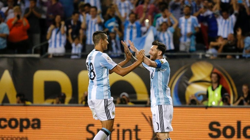 Argentina's Lionel Messi, right, celebrates his goal with Erik Lamela (18) during a Copa America Centenario group D soccer match against Panama at Soldier Field Friday, June 10, 2016, in Chicago. (AP Photo/Charles Rex Arbogast)