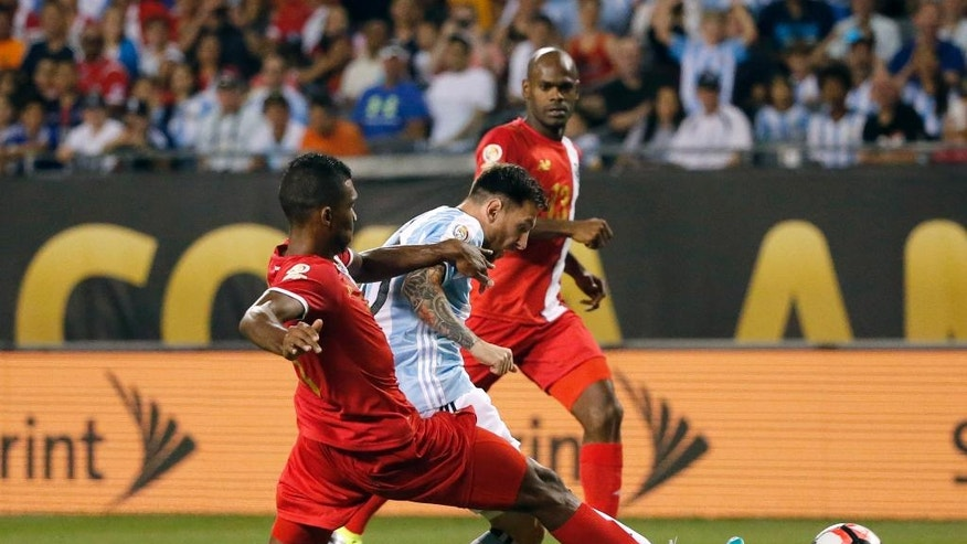 Argentina's Lionel Messi scores a goal against Panama's Roderick Miller during a Copa America Centenario group D soccer match at Soldier Field Friday, June 10, 2016, in Chicago. (AP Photo/Charles Rex Arbogast)