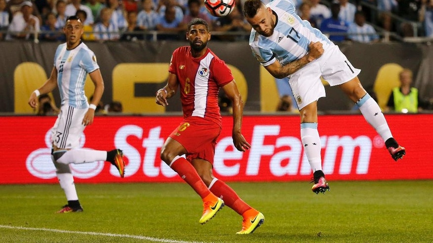 Argentina's Nicolas Otamendi (17) scores a goal with a header during a Copa America Centenario group D soccer match against Panama at Soldier Field Friday, June 10, 2016, in Chicago. (AP Photo/Charles Rex Arbogast)