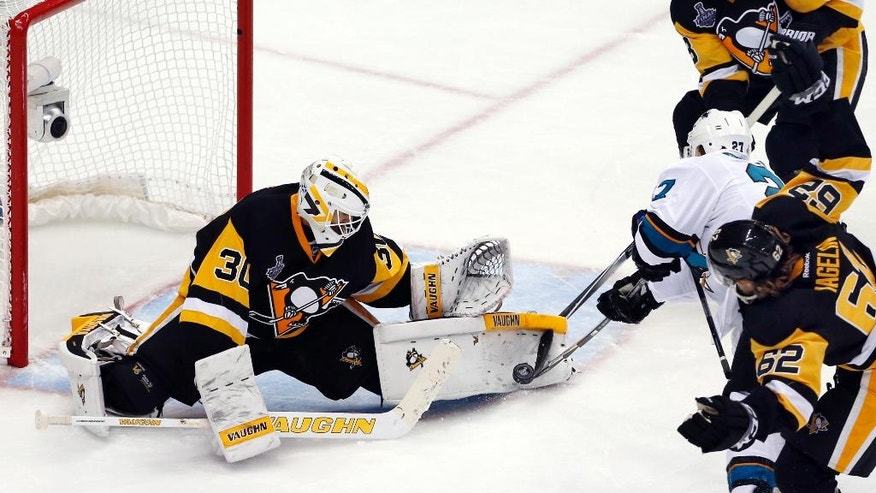 Pittsburgh Penguins goalie Matt Murray (30) stops a shot by San Jose Sharks' Joonas Donskoi (27) during the third period in Game 5 of the NHL hockey Stanley Cup Finals on Thursday, June 9, 2016, in Pittsburgh. (AP Photo/Gene J. Puskar)