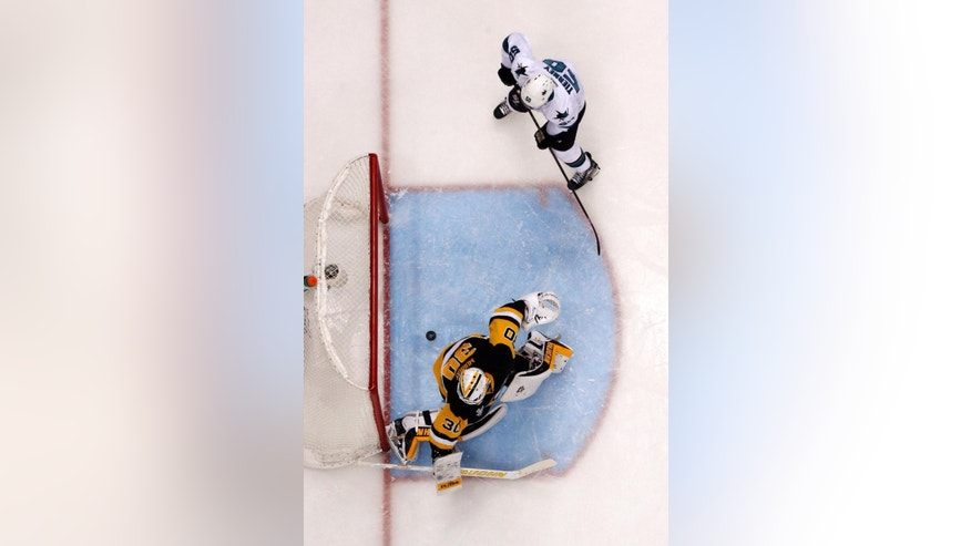 San Jose Sharks' Chris Tierney (50) watches as a shot by Sharks' Brent Burns gets past Pittsburgh Penguins goalie Matt Murray (30) for a goal during the first period of Game 5 of the NHL hockey Stanley Cup Final series Thursday, June 9, 2016, in Pittsburgh. The Sharks won 4-2. (AP Photo/Gene J. Puskar)