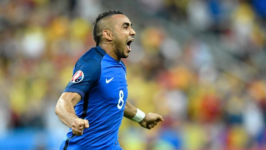 France's Dimitri Payet celebrates after scoring his side's second goal during the Euro 2016 Group A soccer match between France and Romania, at the Stade de France, in Saint-Denis, north of Paris, Friday, June 10, 2016.  (AP Photo/Martin Meissner)