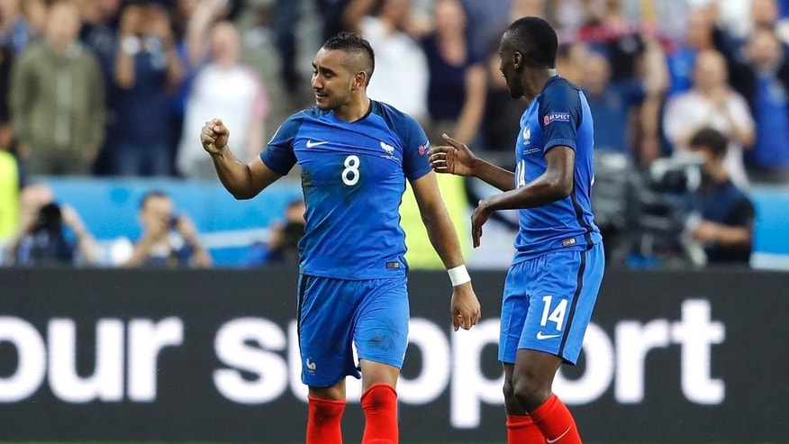 France's Dimitri Payet, left, celebrates with his teammate Blaise Matuidi after scoring his side's second goal during the Euro 2016 Group A soccer match between France and Romania, at the Stade de France, in Saint-Denis, north of Paris, Friday, June 10, 2016. (AP Photo/Frank Augstein)