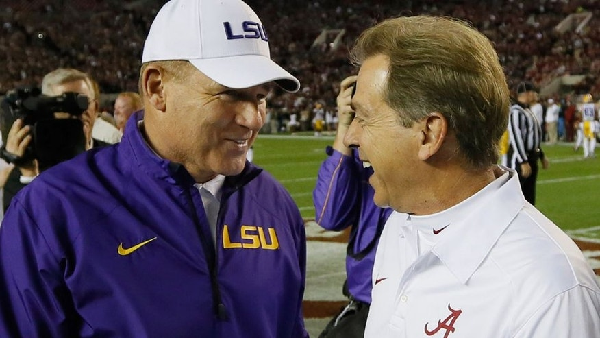 TUSCALOOSA, AL - NOVEMBER 09: (L-R) Head coach Les Miles of the LSU Tigers talks with head coach Nick Saban of the Alabama Crimson Tide before the game at Bryant-Denny Stadium on November 9, 2013 in Tuscaloosa, Alabama. (Photo by Kevin C. Cox/Getty Images)