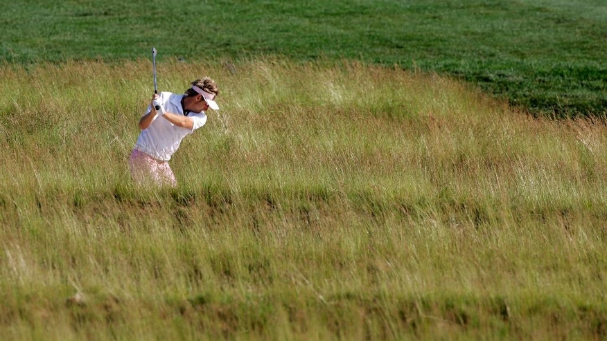 ADVANCE FOR WEEKEND EDITIONS, JUNE 11-12 - In this June 15, 2007, file photo, Ian Poulter, of England, hits from the tall grass during the second round of the  U.S. Open Golf Championship at the Oakmont Country Club in Oakmont, Pa. The U.S. Open returns to perhaps the most storied, and feared, championship golf course in America.  (AP Photo/Charles Krupa, File)