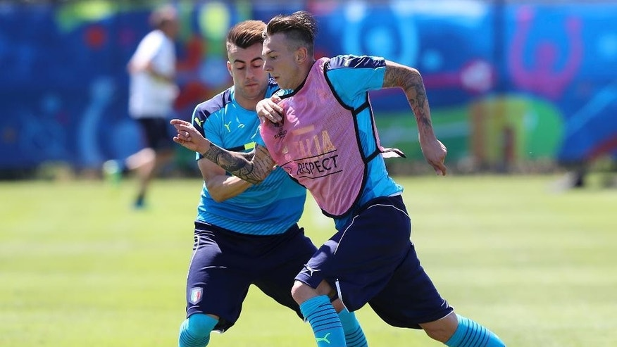 Italy's Stephan El Shaarawy, left, challenges for the ball with Italy's Federico Bernardeschi during a training session at the Bernard Gasset center in Montpellier, France, Thursday, June 9, 2016. Italy will face Belgium in a Euro 2016 Group E soccer match in Lyon on Monday, June 13, 2016. (AP Photo/Antonio Calanni)