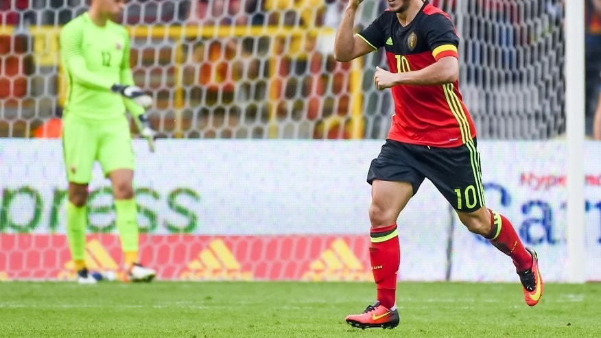 Belgium's Eden Hazard celebrates after he scored against Norway during their friendly soccer match at the King Baudouin Stadium in Brussels on Sunday June 5, 2016. (AP Photo/Geert Vanden Wijngaert)
