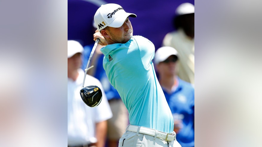 Daniel Berger watches his tee shot on the first tee in the third round of the FedEx St. Jude Classic Golf Tournament, Saturday, June 11, 2016, in Memphis, Tenn. (AP Photo/Rogelio V. Solis)