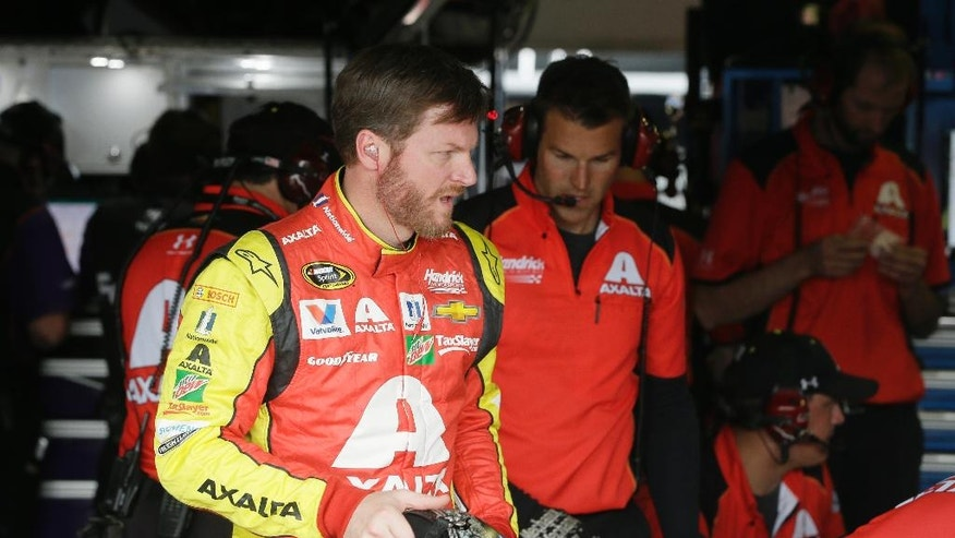 Driver Dale Earnhardt Jr., approaches his car before a practice session for the NASCAR Sprint Cup series auto race at Michigan International Speedway, Friday, June 10, 2016 in Brooklyn, Mich. (AP Photo/Carlos Osorio)