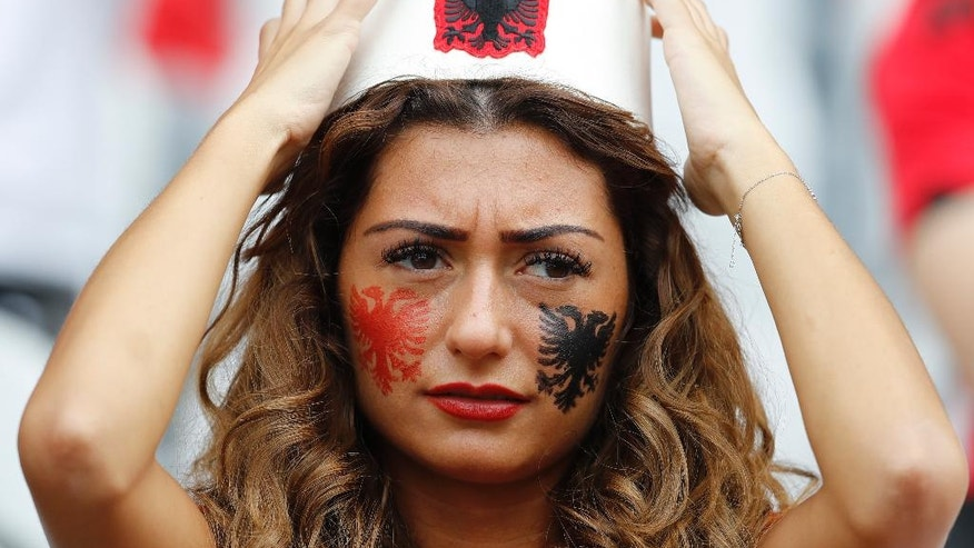 An Albania team supporter adjust her hat as she waits for the start of the Euro 2016 Group A soccer match between Albania and Switzerland, at the Bollaert stadium in Lens, France, Saturday, June 11, 2016. (AP Photo/Frank Augstein)