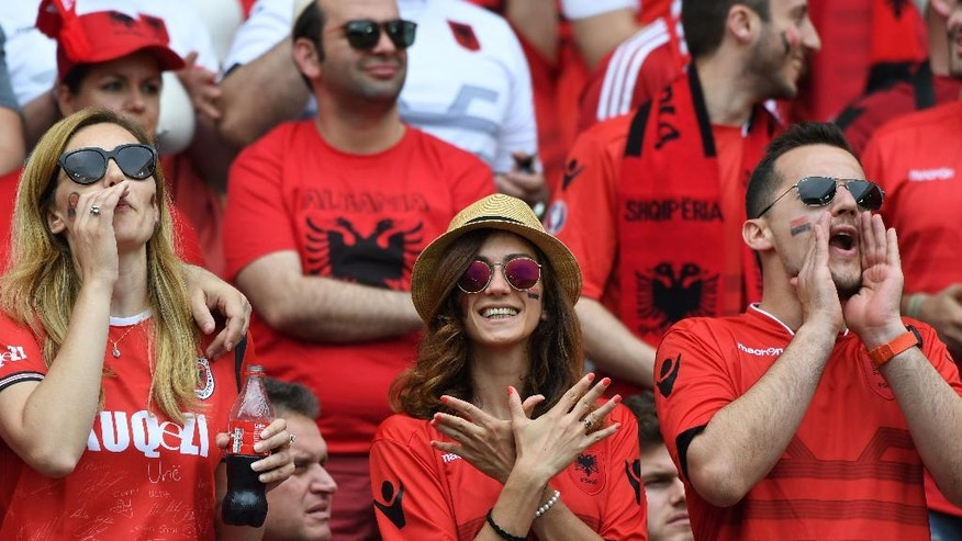 Albania supporters cheer on the stands before  the Euro 2016 Group A soccer match between Albania and Switzerland, at the Bollaert stadium in Lens, France, Saturday, June 11, 2016. (AP Photo/Geert Vanden Wijngaert)