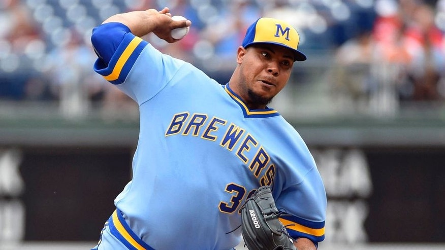 Milwaukee Brewers starting pitcher Wily Peralta throws during the first inning of a baseball game against the Philadelphia Phillies, Sunday, June 5, 2016, in Philadelphia. (AP Photo/Derik Hamilton)
