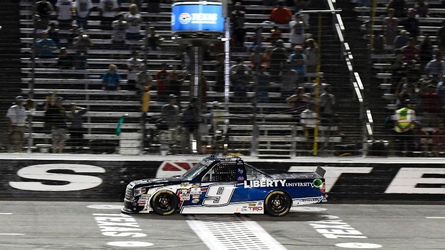 William Byron crosses the finish line to win the NASCAR Trucks Series auto race at Texas Motor Speedway, Friday, June 10, 2016, in Fort Worth, Texas. (AP Photo/Larry Papke)