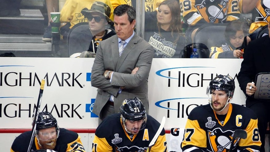 Pittsburgh Penguins coach Mike Sullivan stands behind Patric Hornqvist, Evgeni Malkin and Sidney Crosby from left, during the third period in Game 5 of the NHL hockey Stanley Cup Finals against the San Jose Sharks on Thursday, June 9, 2016, in Pittsburgh. The Sharks won 4-2. (AP Photo/Gene J. Puskar)