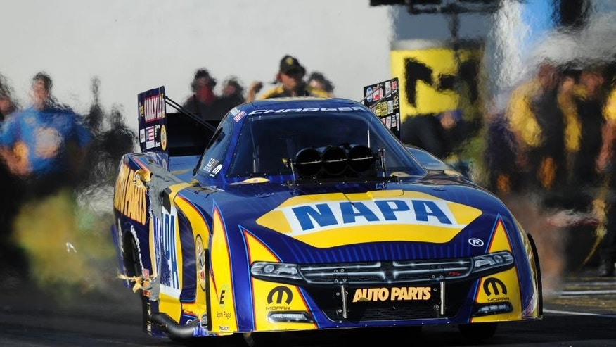 In this photo provided by the NHRA, Ron Capps drives during Funny Car qualifying for the NHRA Summernationals drag races at Old Bridge Township Raceway Park on Friday, June 10, 2016, in Englishtown, N.J. Capps took the top spot with a run of 3.870 seconds at 318.62 mph. (Jerry Foss/MHRA via AP)