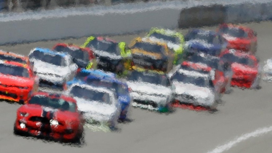 Heat waves distort this image of drivers following the pace car during the NASCAR Xfinity series auto race at Michigan International Speedway, Saturday, June 11, 2016 in Brooklyn, Mich. (AP Photo/Carlos Osorio)
