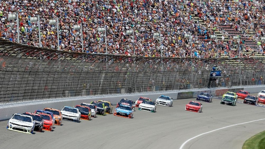 Driver Alex Bowman leads the field into the first turn during the NASCAR Xfinity series auto race at Michigan International Speedway, Saturday, June 11, 2016 in Brooklyn, Mich. (AP Photo/Carlos Osorio)