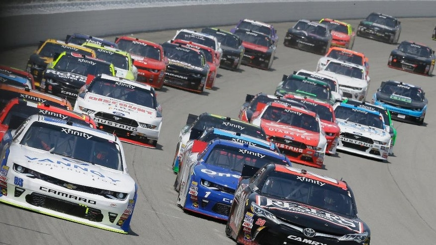 Driver Alex Bowman, left, and Erik Jones lead the field into the first turn during the NASCAR Xfinity series auto race at Michigan International Speedway, Saturday, June 11, 2016 in Brooklyn, Mich. (AP Photo/Carlos Osorio)