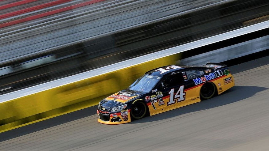 BROOKLYN, MI - JUNE 10: Tony Stewart, driver of the #14 Rush Truck Centers/Mobil 1 Chevrolet, drives during qualifying for the NASCAR Sprint Cup Series FireKeepers Casino 400 at Michigan International Speedway on June 11, 2016 in Brooklyn, Michigan. (Photo by Daniel Shirey/NASCAR via Getty Images)