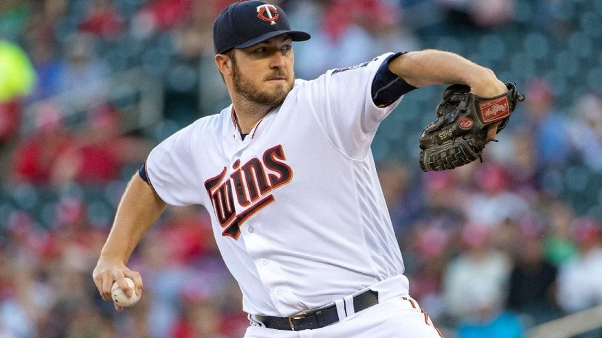 Minnesota Twins starting pitcher Phil Hughes delivers a pitch in the first inning against the Tampa Bay Rays.