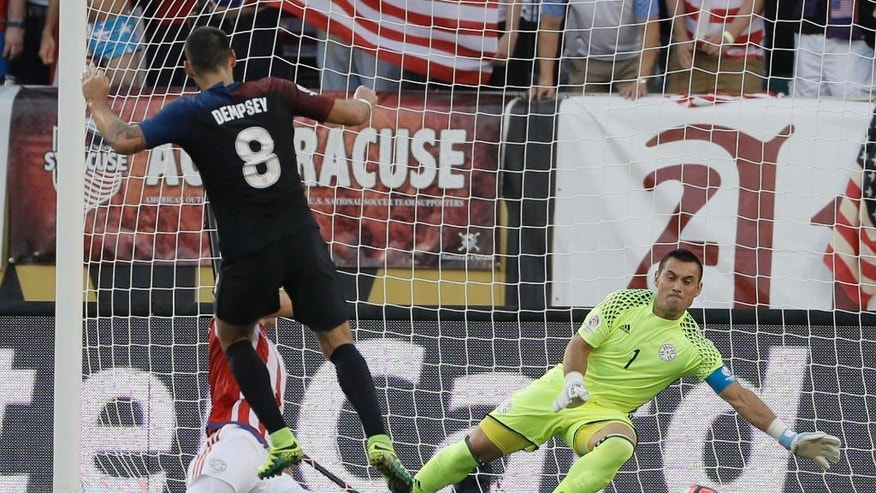 United States' Clint Dempsey, center, scores a goal past Paraguay's Justo Villar, right, and Fabian Balbuena during the first half of a Copa America Group A soccer match Saturday, June 11, 2016, in Philadelphia. (AP Photo/Matt Slocum)