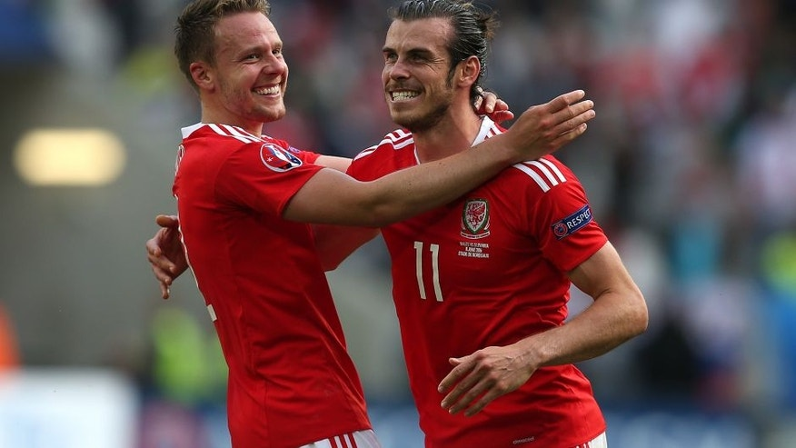 BORDEAUX, FRANCE - JUNE 11: Gareth Bale of Wales celebrates at full-time with team-mate Chris Gunther following the UEFA Euro 2016 Group B match between Wales and Slovakia at Nouveau Stade de Bordeaux on June 11, 2016 in Bordeaux, France. (Photo by Chris Brunskill Ltd/Getty Images)