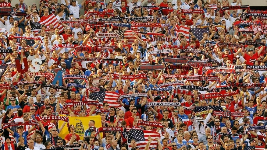 Fans stand for the singing of the United States' national anthem ahead of the first half of a Copa America Group A soccer match between the U.S. and Paraguay, Saturday, June 11, 2016, in Philadelphia. (AP Photo/Matt Rourke)