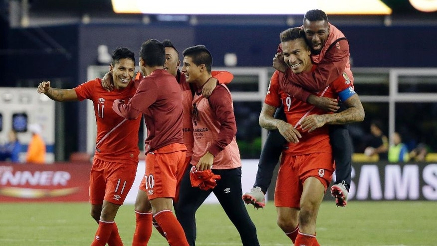 Peru's Raul Ruidiaz, left, celebrates with teammates after his goal lifted Peru to a 1-0 win over Brazil in a Copa America Group B soccer match on Sunday, June 12, 2016, in Foxborough, Mass. (AP Photo/Elise Amendola)