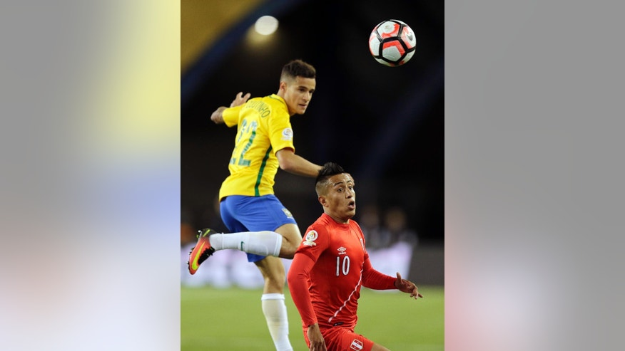 Brazil's Philippe Coutinho, left, and Peru's Christian Cueva (10) chase the ball during the first half of a Copa America Group B soccer match on Sunday, June 12, 2016, in Foxborough, Mass. (AP Photo/Charles Krupa)