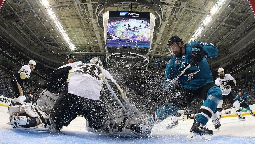 Pittsburgh Penguins goalie Matt Murray (30) defends a shot by San Jose Sharks right wing Joonas Donskoi, from Finland, right, during the second period of Game 6 of the NHL hockey Stanley Cup Finals in San Jose, Calif., Sunday, June 12, 2016. (Bruce Bennett/Getty Images via AP, Pool)