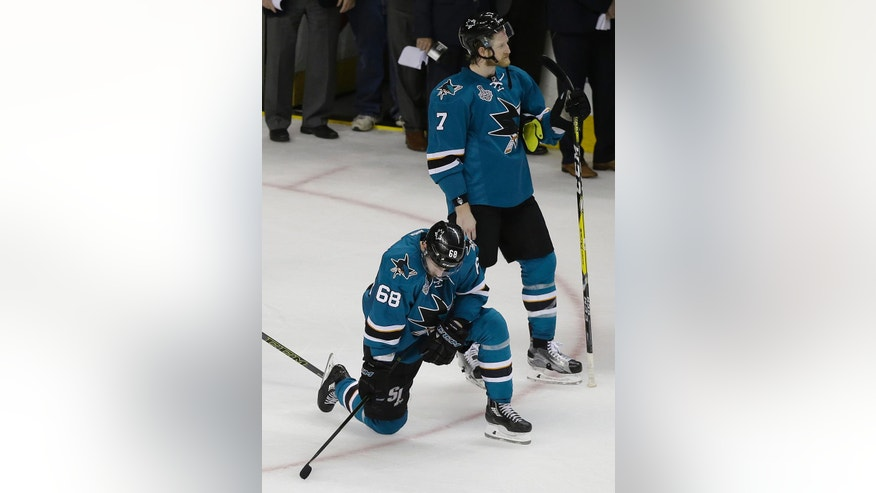 San Jose Sharks right wing Melker Karlsson (68), from Sweden, and defenseman Paul Martin (7) react after losing Game 6 of the NHL hockey Stanley Cup Finals against the Pittsburgh Penguins in San Jose, Calif., Sunday, June 12, 2016. The Penguins won 3-1 to win the series 4-2. (AP Photo/Eric Risberg)