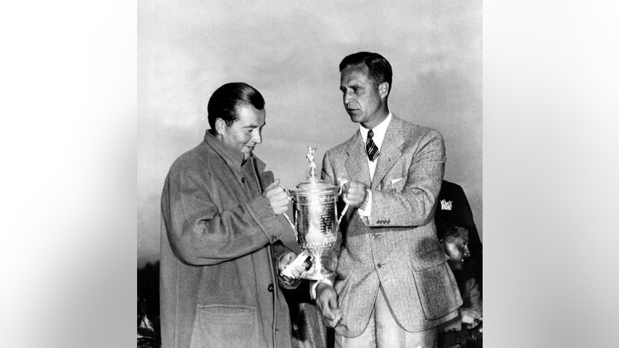 FILE -- In this in this June 8, 1935 file photo, Sam Parks Jr., left, of Pittsburgh, is presented with the trophy cup by Prescott Bush, president of the American Golf Association, after winning the U.S. Open Golf Championship at Oakmont Country Club in Oakmont, Pa. Parks Jr. rates among the most unlikely winners in U.S. Open history, especially compared with the Hall of Fame list of champions at Oakmont.  (AP Photo, File)