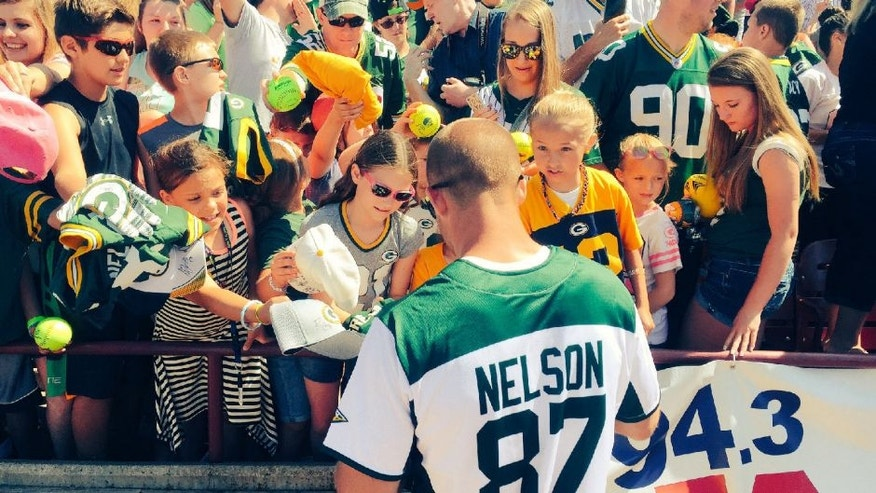 Green Bay Packers receiver Jordy Nelson signs autographs after his annual charity softball game.