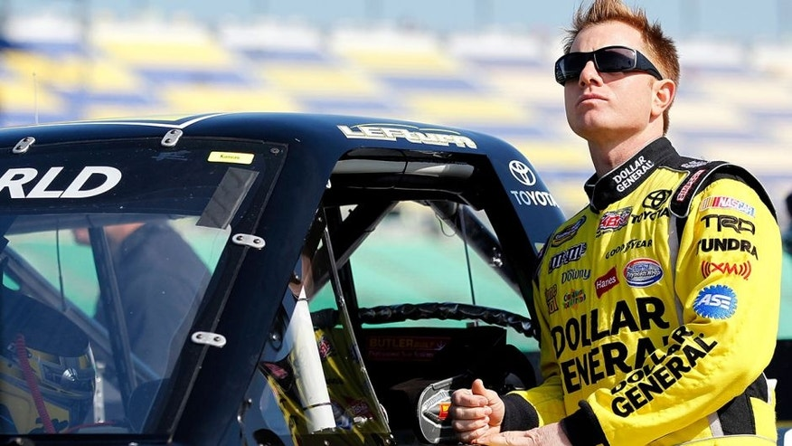 KANSAS CITY, KS - APRIL 21: Jason Leffler, driver of the #18 Shore Lodge Toyota, looks on during qualifying for NASCAR Camping World Truck Series SFP 250 at Kansas Speedway on April 21, 2012 in Kansas City, Kansas. (Photo by Geoff Burke/Getty Images for NASCAR)