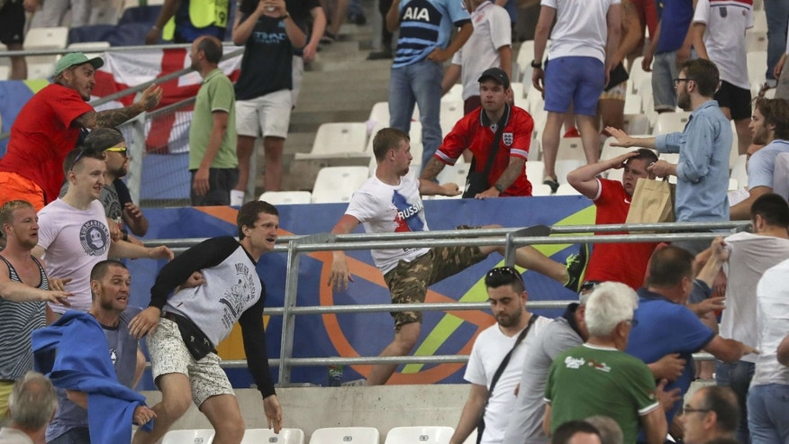 Clashes break out in the stands during the Euro 2016 Group B soccer match between England and Russia, at the Velodrome stadium in Marseille, France, Saturday, June 11, 2016.