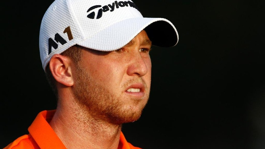 Daniel Berger stares down the course as he walks to the 17th green on his way to winning the FedEx St. Jude Classic golf tournament, Sunday, June 12, 2016, in Memphis, Tenn. Berger won the tournament on Sunday for his first PGA Tour title, shooting a 3-under 67 to hold off Phil Mickelson, Steve Stricker and Brooks Koepka by three strokes. (AP Photo/Rogelio V. Solis)