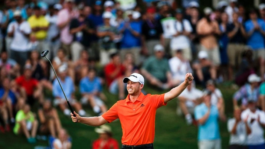 Daniel Berger celebrates after finishing the eighteenth hole and winning the FedEx St. Jude Classic golf tournament, Sunday, June 12, 2016, in Memphis, Tenn. Berger won the tournament on Sunday for his first PGA Tour title, shooting a 3-under 67 to hold off Phil Mickelson, Steve Stricker and Brooks Koepka by three strokes. (Brad Vest/The Commercial Appeal via AP) MANDATORY CREDIT