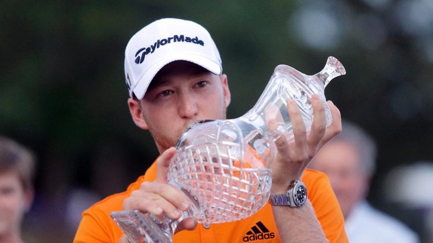 Daniel Berger kisses the FedEx St. Jude Classic trophy after winning the golf tournament, Sunday, June 12, 2016, in Memphis, Tenn. Berger won the tournament on Sunday for his first PGA Tour title, shooting a 3-under 67 to hold off Phil Mickelson, Steve Stricker and Brooks Koepka by three strokes. (Nikki Boertman/The Commercial Appeal)