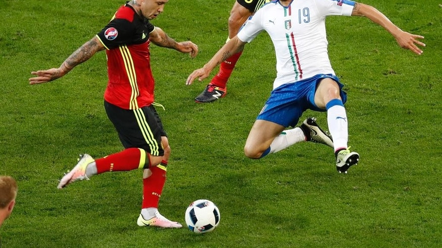 Belgium's Radja Nainggolan vies for the ball with Italy's Leonardo Bonucci during the Euro 2016 Group E soccer match between Belgium and Italy at the Grand Stade in Decines-Charpieu, near Lyon, France, Monday, June 13, 2016. (AP Photo/Michael Sohn)