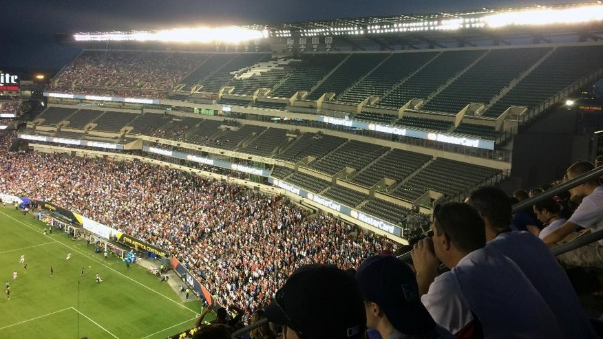 In this Saturday, June 11, 2016 photo, fans watch a Copa America Group A soccer match between the United States and Paraguay in Philadelphia. The Copa America hasn't been like the 1994 World Cup, which set attendance records with crowds averaging nearly 69,000. That's because the allure of the Copa America isn't close to that of the World Cup. (AP Photo/Oskar F. Garcia)