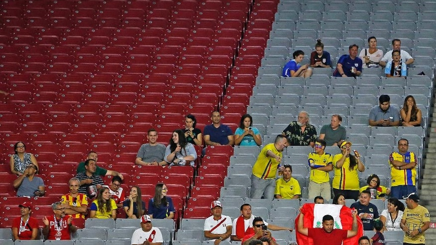 In this June 8, 2016 photo, empty seats are shown during a Copa America group C soccer match between Ecuador and Peru in Glendale, Ariz. The Copa America hasn't been like the 1994 World Cup, which set attendance records with crowds averaging nearly 69,000. That's because the allure of the Copa America isn't close to that of the World Cup. (AP Photo/Ross D. Franklin)