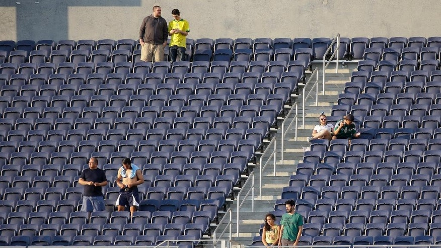 In this june 8, 2016 photo, many empty seats are shown during a Copa America group B soccer match between Haiti and Brazil at Camping World Stadium in Orlando, Fla. The Copa America hasn't been like the 1994 World Cup, which set attendance records with crowds averaging nearly 69,000. That's because the allure of the Copa America isn't close to that of the World Cup. (AP Photo/John Raoux)